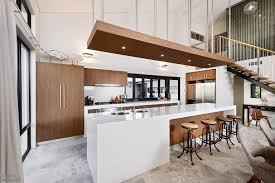 wonderful breakfast space with round stools on a big kitchen wonderful breakfast space with round stools on a big kitchen island with sinks and recessed lamps