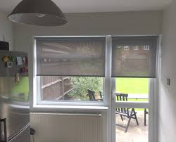 sunscreen roller blinds on door and window in kitchen surrey