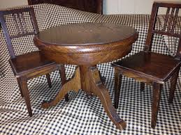 antique salesman sample mission style round oak dining table and 2