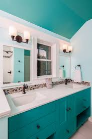 bathroom wall sconce in simple bathroom design with towel bar and