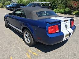 the with the blue mustang blue mustang white racing stripes coastal sign design llc