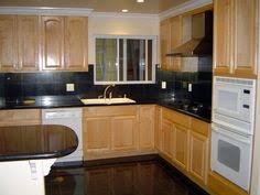 Kitchen Colors With Oak Cabinets And Black Countertops Light Colored Oak Cabinets With Granite Countertop Natural Maple