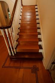 How To Put Rug On Stairs by Wood And Carpet Stairs