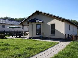 a modern bungalow with a wood burning stove on a small holiday