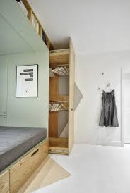 this teenager u0027s bedroom has a built in bed and storage for almost