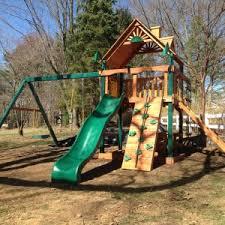 Backyard Swing Set Ideas Exterior Oak Wood Gorilla Swing Sets With Natural Green Grass For