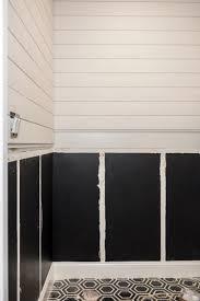 a modern powder room using black shiplap