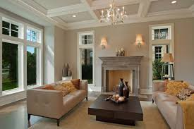 stone fireplace on the wooden floor with rugs in family room can