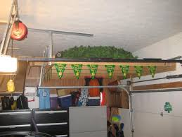 garage loft ideas backyards above garage door storage img 0771 diy over ideas