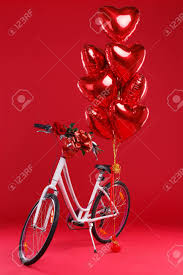 large gift bow on a background in the studio a bicycle with a gift bow