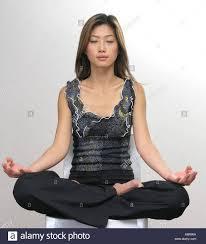 High Sitting Chair Oriental Woman In Sukhasana Yoga Pose Sitting On A High Chair