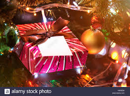 christmas gift for kids in christmas tree colourful background