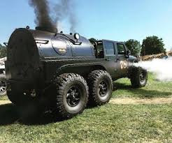 mobil jeep offroad this jeep wrangler has six wheels and a steam engine the drive