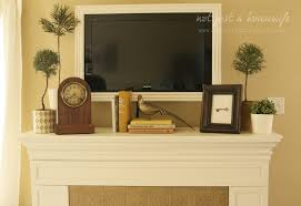 fireplace screen flat tv with oclock and art plus indoor potted