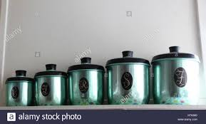 antique kitchen canisters set of anodised coloured antique kitchen canisters stock photo