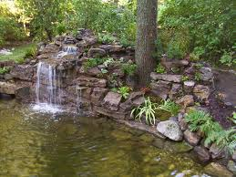 backyard garden house design with ponds and stone waterfall plus