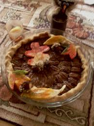 happy american thanksgiving pecan pie decorated with pie crust