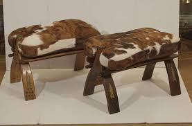 camel saddle stool with hide and leather seat pair available at