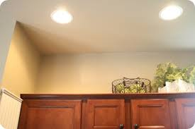 Decorating Ideas For The Top Of Kitchen Cabinets Pictures How To Decorate Above Kitchen Cabinets From Thrifty Decor