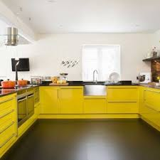 yellow kitchen design love the combo of the yellow cabinets and gray walls doing a
