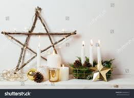 christmas decoration golden ornaments candles lights stock photo