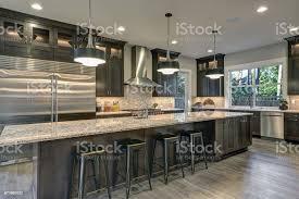 light brown kitchen cabinets modern modern kitchen with brown kitchen cabinets stock photo image now