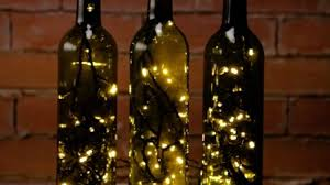 how to decorate a wine bottle for a gift how to turn empty wine bottles into accent lights diy projects