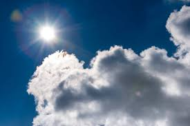 sun on the blue summer sky with clouds