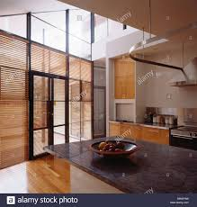 wooden venetian blinds on glass doors in large double height