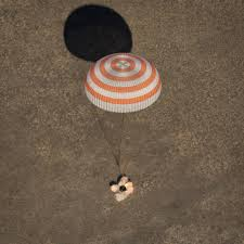 space station crew returns to earth safely on soyuz capsule