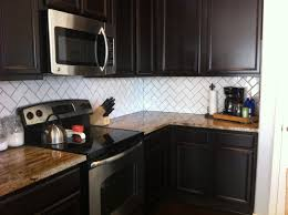 interior light grey herringbone mosaic tile kitchen backsplash