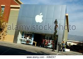 Commercial Lamp Post Christmas Decorations by Apple Store Facade With Christmas Decorations Lamppost Next To It