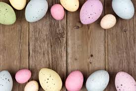 speckled easter eggs speckled easter egg border against rustic wood stock image