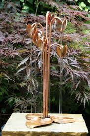 copper cyclamen water feature from metallic garden
