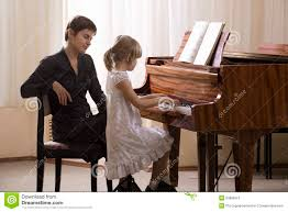 Photography Teacher And Teacher Playing Piano Stock Photography Image 33889312