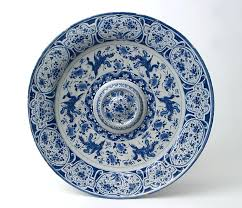 metlox pottery patterns charger in blue and white delftware