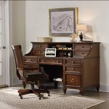 black floating desk with storage within computer desk in living