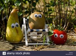 funny vegetables and fruits with eyes in the sun stock photo