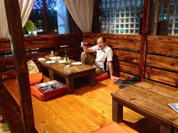 japanese traditional kitchen the ambience is traditional okinawan japanese inside with table and