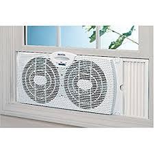 electrically reversible twin window fan amazon com holmes twin window fan reversible dual blade exhaust