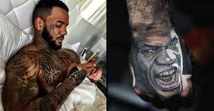 the a rapper with his ink on point tattoodo