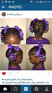 little black braids purple beads hairstyle cornrow ponytail
