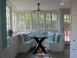cottage dining room with built in bookshelf u0026 chandelier in