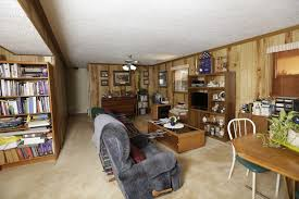 painting paneling in basement to refresh a dated basement paint the wood paneling and brick the
