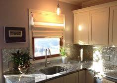 white kitchen cabinets with mirror backsplash house beautiful