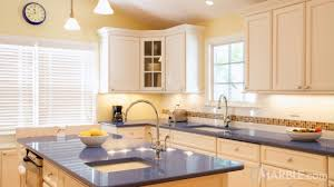 blue kitchen cabinets and yellow walls marble light yellow walls and a yellow range are