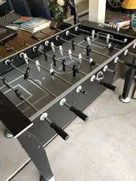 classic sport foosball table classic sport foosball table used in an indoor game room like new