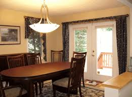 dining room table and bench round chandelier red and black rugs dining table with bench seats