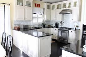 black cabinets with black appliances white grey yellow kitchen dark cabinets backsplash wood countertops