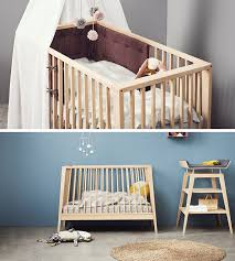 this baby cot is designed to transform into a bed and couch as the